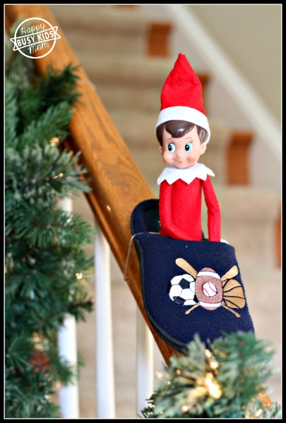 Day 7 Sledding Elf, slipper is tied with dental floss to banister