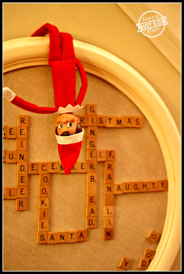 Our Elf on the Shelf is back and playing with our magnetic scrabble board