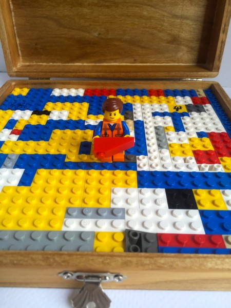 Challenge your child to layout all of their LEGOS in the bottom of the hand painted LEGO box.