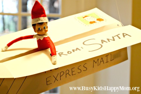 Elf on the shelf arrival idea by Santa Express plane.